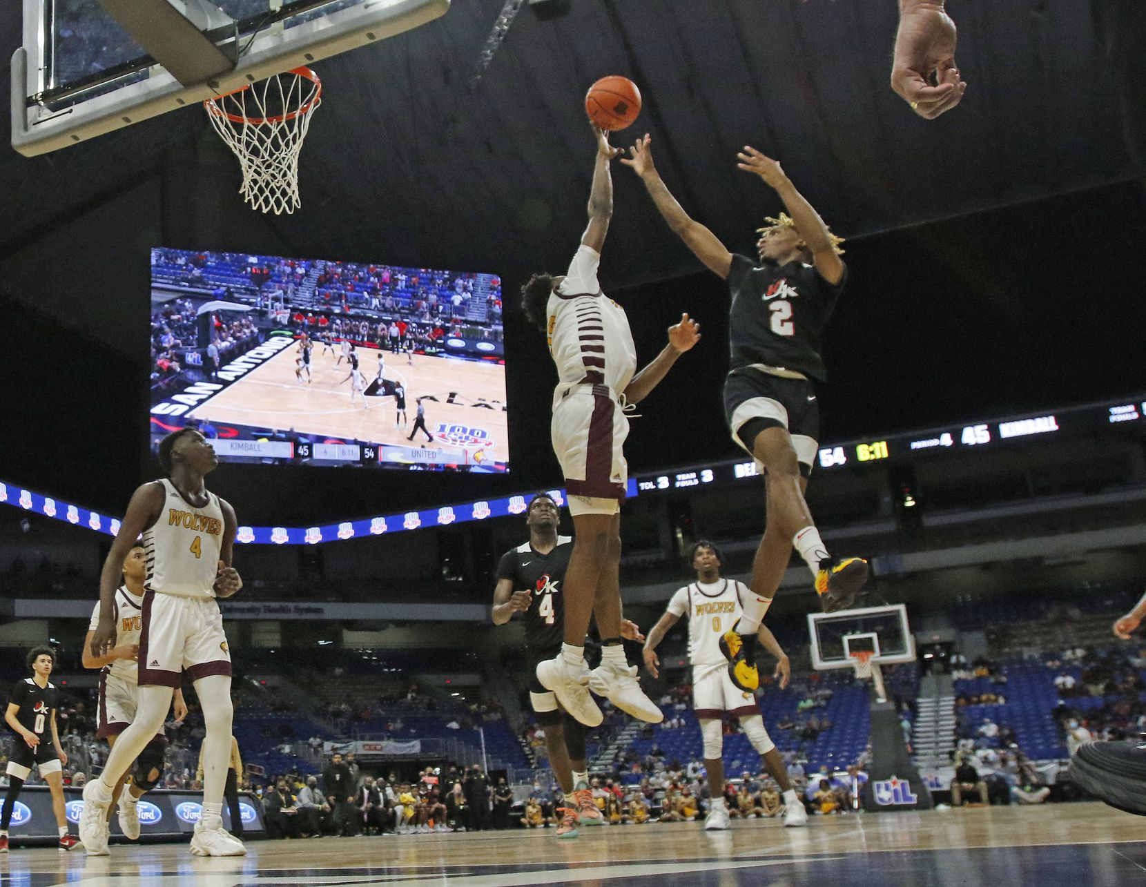 Dallas Kimball Arterio Morris #2 shots over a Beaumont defender. UIL boys Class 5A basketball state championship game on Friday, March 12, 2021 at the Alamodome.