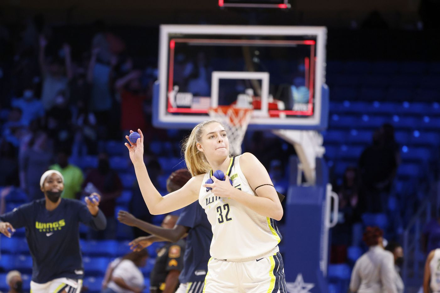 Dallas Wings center/forward Bella Alarie (32) throws ball to fans after they defeated the Los Angeles Sparks 87-84 during a WNBA basketball game in Arlington, Texas on Sunday, Sept. 19, 2021. (Michael Ainsworth/Special Contributor)