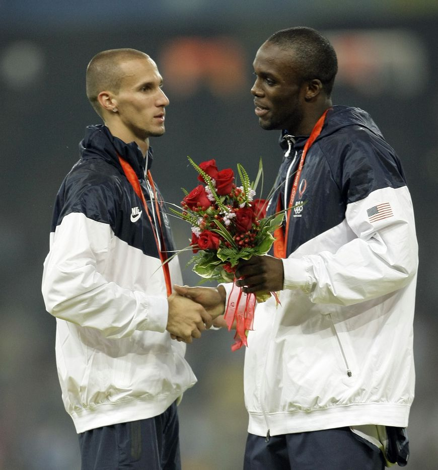 2008 Beijing Olympics: Silver medalist Jeremy Wariner,left, congratulates gold medal winner LaShawn Merritt after the Men's 400 meters medal ceremony at the National Stadium  in Beijing, China Thursday August 21, 2008.
