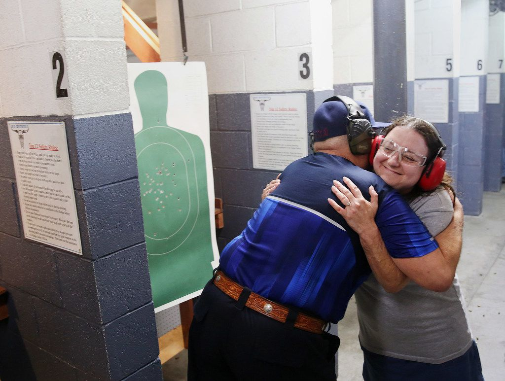 Instructor Mark Giordonello (left) hugs Angela Carter of Santa Fe, Texas, after she passed a license to carry class hosted by Mark Giordonello at Big Kountry Shooting and Archery gun range in Alvin, Texas, Saturday May 19, 2018. Carter took the class with her husband, William Carter. On Friday morning, 10 people were killed and 13 were injured after a shooting at Santa Fe High School. Angela Carter's daughter Victoria Garcia, 16, was in the school at the time of the shooting and ran outside during history class. Dimitrios Pagourtzis was booked into the Galveston County Jail on capital murder charges. The class was scheduled before the shooting occurred.
