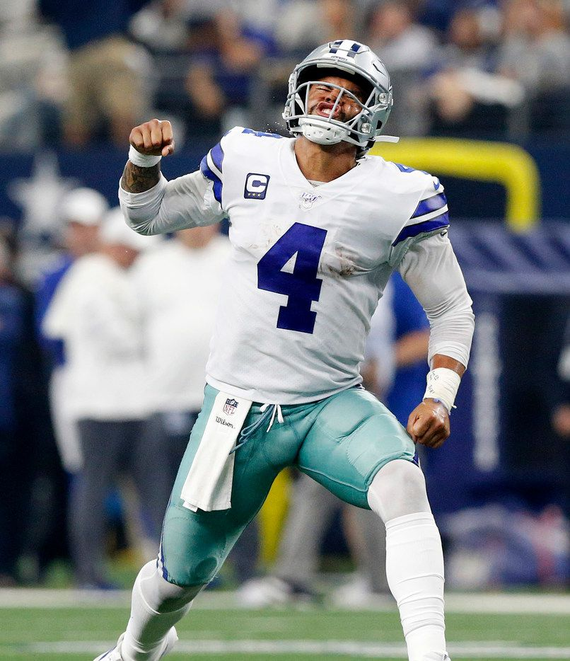 Dallas Cowboys quarterback Dak Prescott (4) celebrates his touchdown pass to wide receiver Amari Cooper during the second quarter against the New York Giants at AT&T Stadium in Arlington, Texas, Sunday, September 8, 2019. (Tom Fox/The Dallas Morning News)