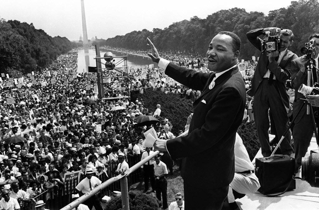 """(FILES)The civil rights leader Martin Luther KIng (C) waves to supporters in this August 28,1963 photo on the Mall in Washington, DC (Washington Monument in background) during the """"March on Washington"""". The conservative Tea Party movement has raised hackles among African-American and civil rights leaders in Washington for organizing a huge weekend rally on August 28, 2010, the anniversary of Martin Luther King Jr's historic """"I Have a Dream"""" speech.Called """"Restoring Honor,"""" the rally organized by rightwing talkshow host Glenn Beck is to take place in front of the Lincoln Memorial, the same location where King delivered his most stirring and best remembered address exactly 47 years earlier. Beck has billed the event as a faith-based show of thanks and support for America's military families, honoring US """"heroes, our heritage and our future."""" AFP PHOTO/FILES (Photo credit should read -/AFP/Getty Images) 01132012xGUIDE 08252013xNEWS 08252013xPOINTS 08292013xBRIEFING"""