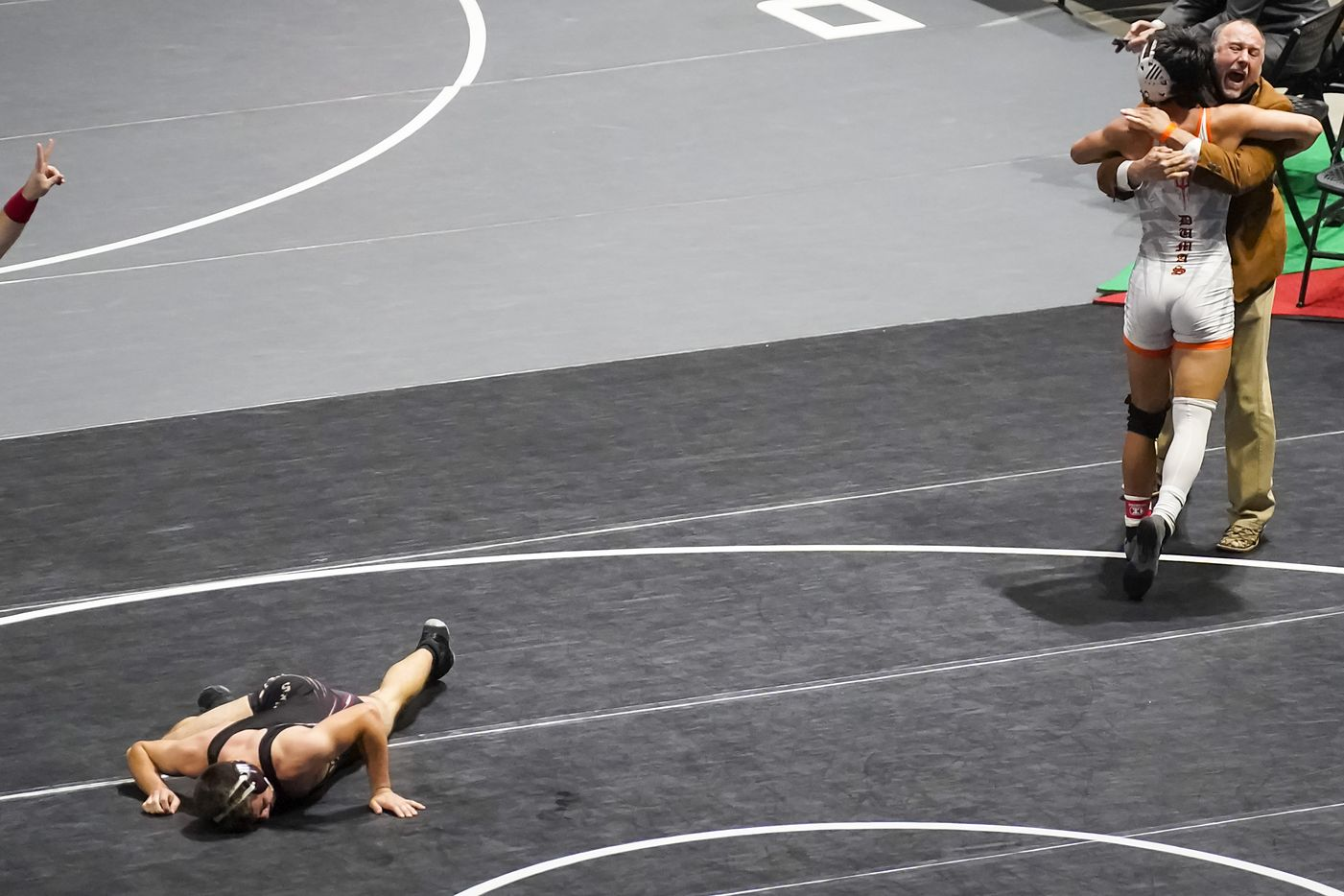 Ahlee Yart of Dumas celebrates after defeatingAnthony Criscione of College Station A&M Consolidated for the 5A boys 138-pound championship during the UIL State Wrestling tournament at the Berry Center on Friday, April 23, 2021, in Cypress, Texas.