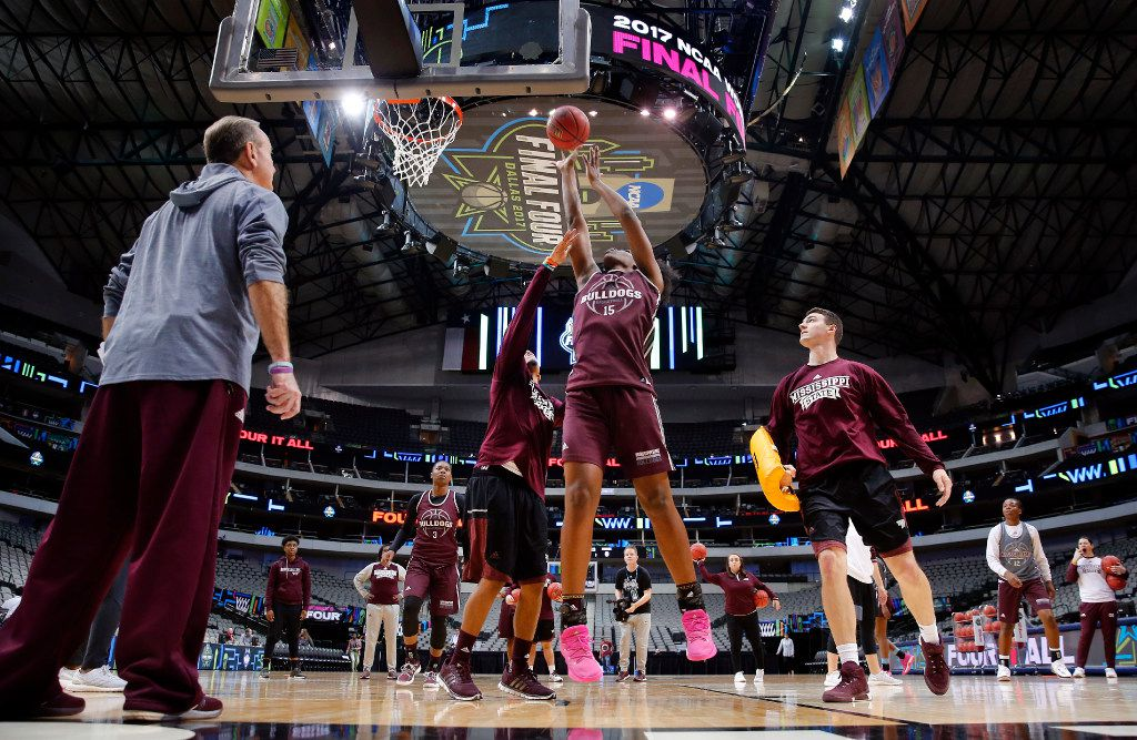 Mississippi State Lady Bulldogs head coach Vic Schaefer (left) watched as center Teaira McCowan (15) worked for a basket Thursday during practice for their NCAA Women's Final Four semifinal game at American Airlines Center in Dallas. Mississippi State faces UConn on Friday. (Tom Fox/Staff Photographer)