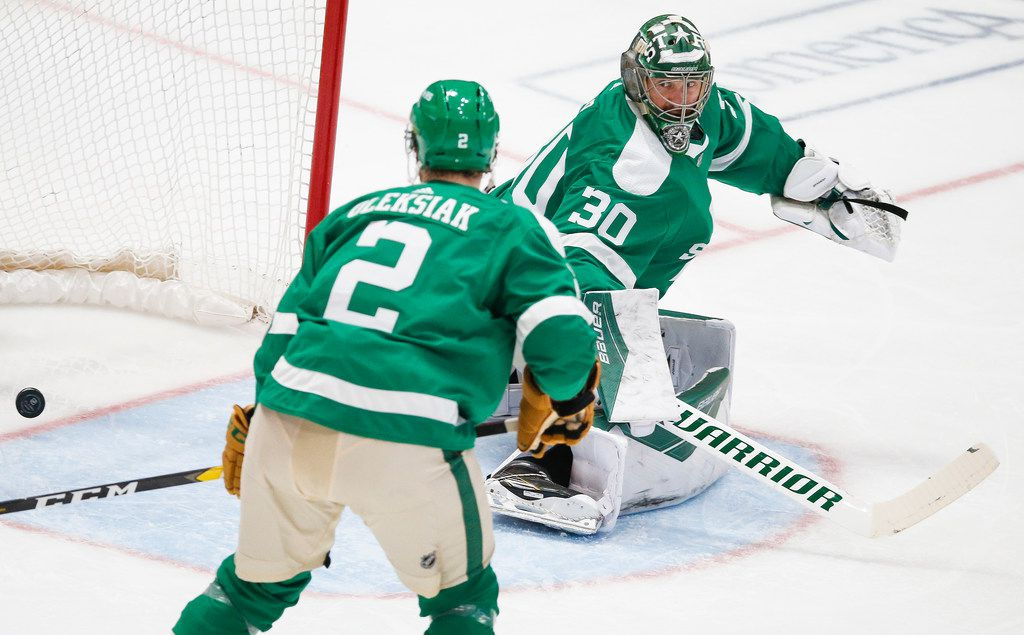 The St. Louis Blues score past Dallas Stars goaltender Ben Bishop (30) and defenseman Jamie Oleksiak (2) during the second period of an NHL matchup between the Dallas Stars and the St. Louis Blues on Friday, Feb. 21, 2020 at American Airlines Center in Dallas. (Ryan Michalesko/The Dallas Morning News)