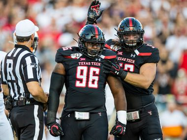 LUBBOCK, TEXAS - SEPTEMBER 07: Defensive lineman Broderick Washington Jr. #96 and defensive lineman Eli Howard V #53 of Texas Tech celebrate a tackle by Washington Jr. during the first half of the college football game between the Texas Tech Red Raiders and the UTEP Miners at Jones AT&T Stadium on September 07, 2019 in Lubbock, Texas.
