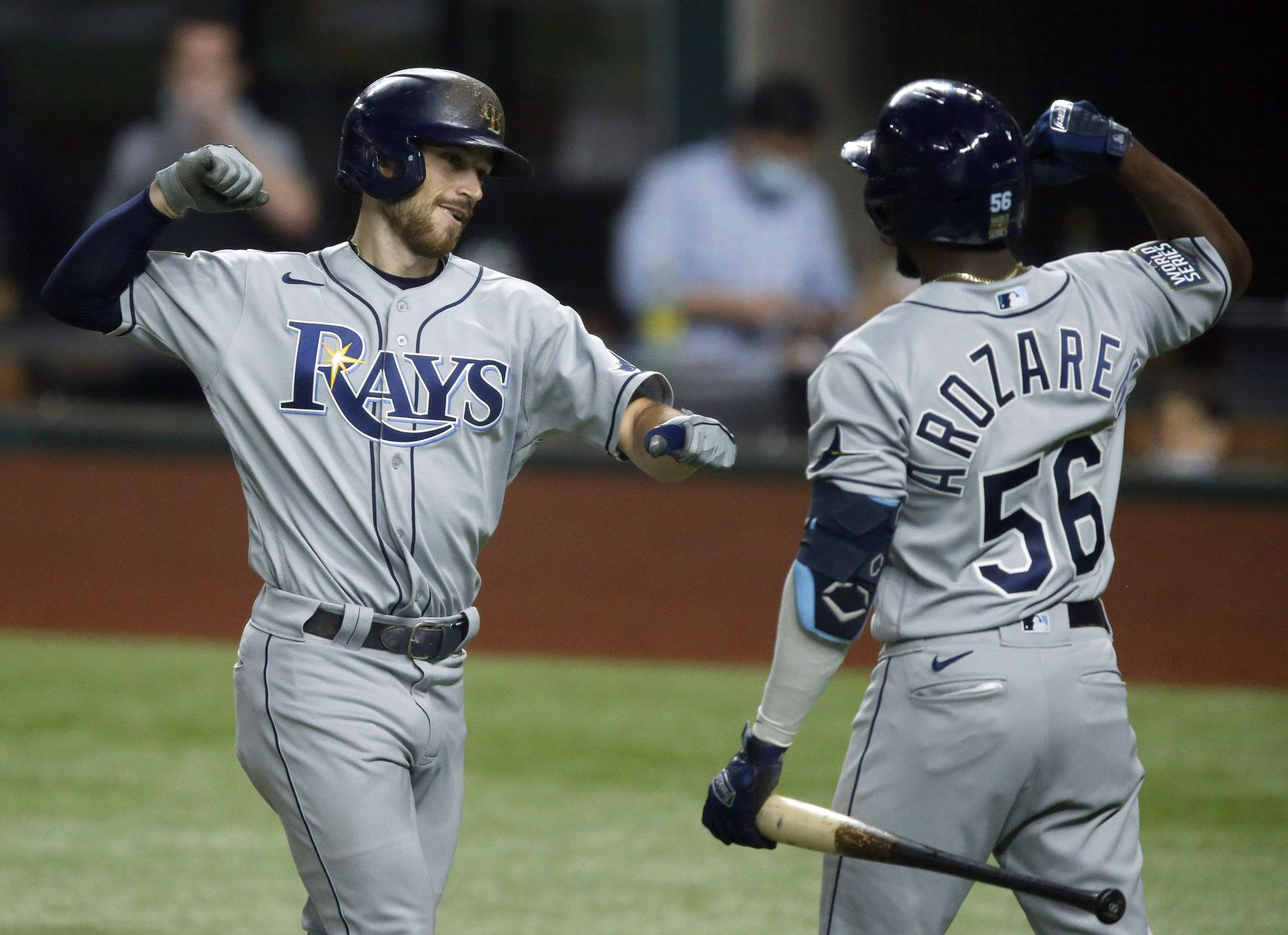 Tampa Bay Rays Brandon Lowe (8) is congratulated on his solo home run by teammate Randy Arozarena (56) during the first inning in Game 2 of the World Series at Globe Life Field in Arlington, Wednesday, October 21, 2020. (Tom Fox/The Dallas Morning News)