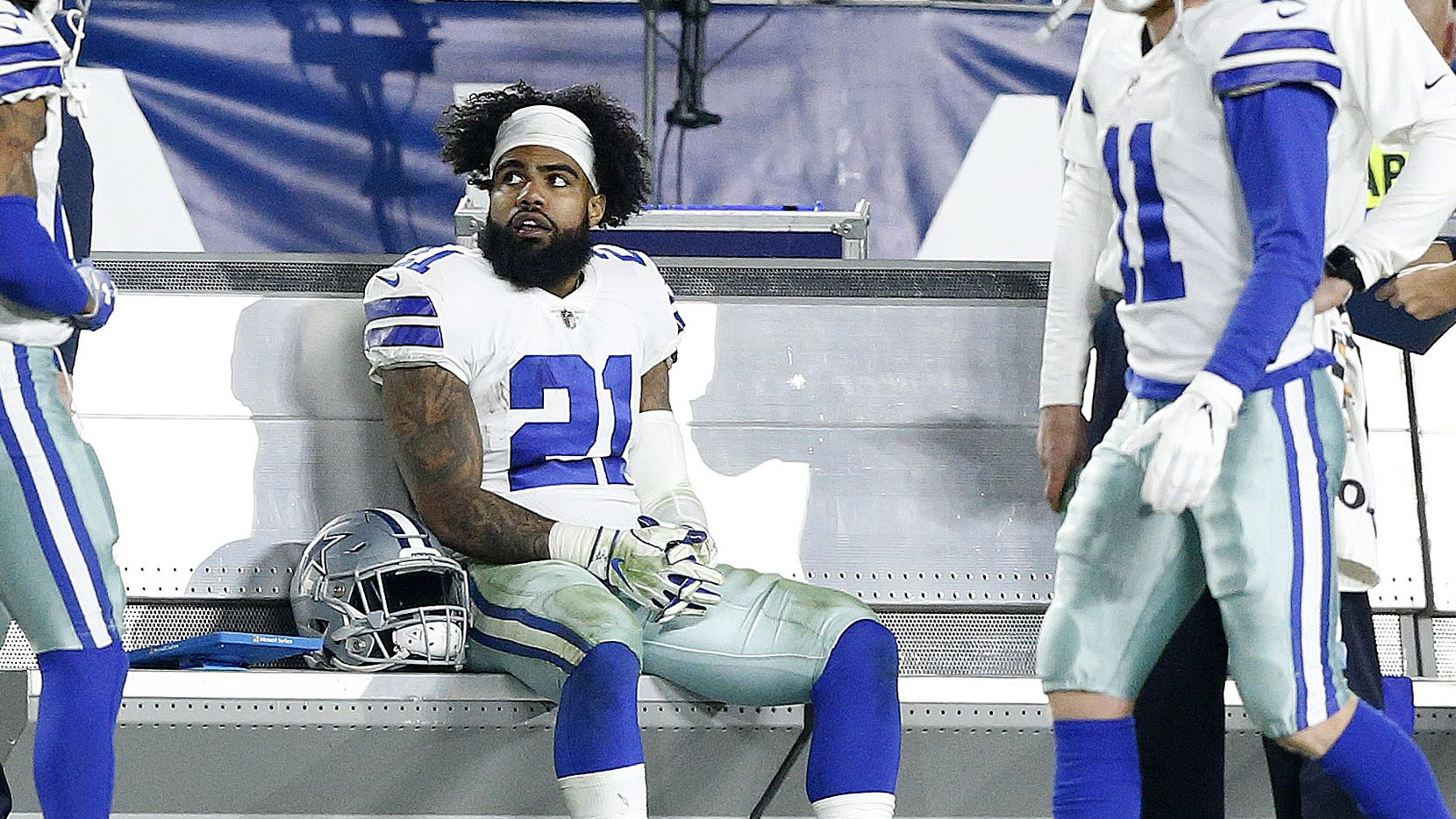 Dallas Cowboys running back Ezekiel Elliott (21) rests on the bench during the third quarter of their NFC Divisional Playoff game against the Los Angeles Rams at Los Angeles Memorial Coliseum in Los Angeles, Saturday, January 12, 2019. Tye Cowboys lost 30-22. (Tom Fox/The Dallas Morning News)