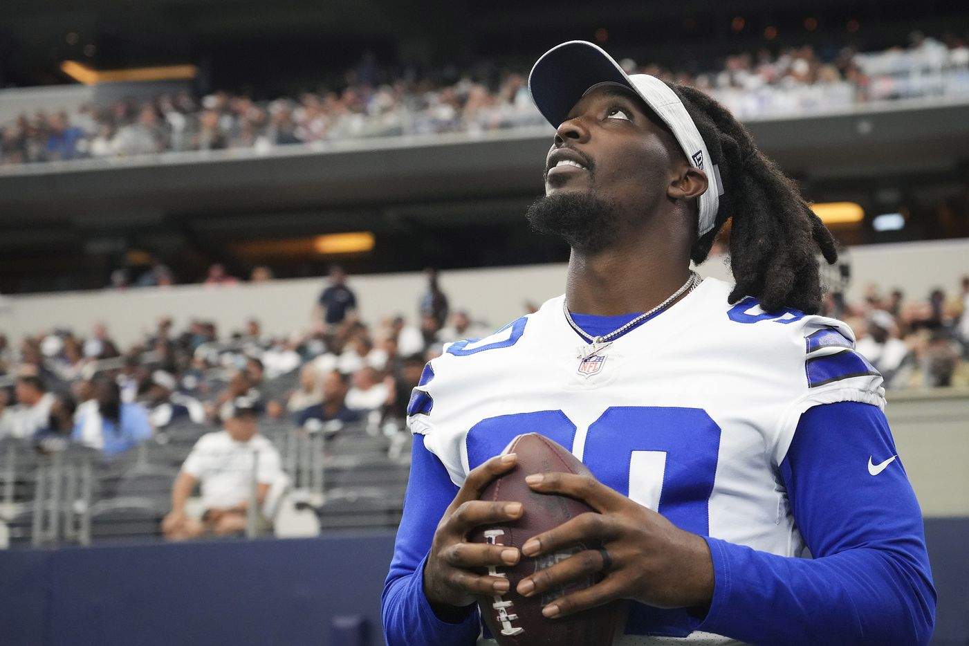 Dallas Cowboys defensive end DeMarcus Lawrence watches from the sidelines during the second half of a preseason NFL football game against the Jacksonville Jaguars at AT&T Stadium on Sunday, Aug. 29, 2021, in Arlington. (Smiley N. Pool/The Dallas Morning News)