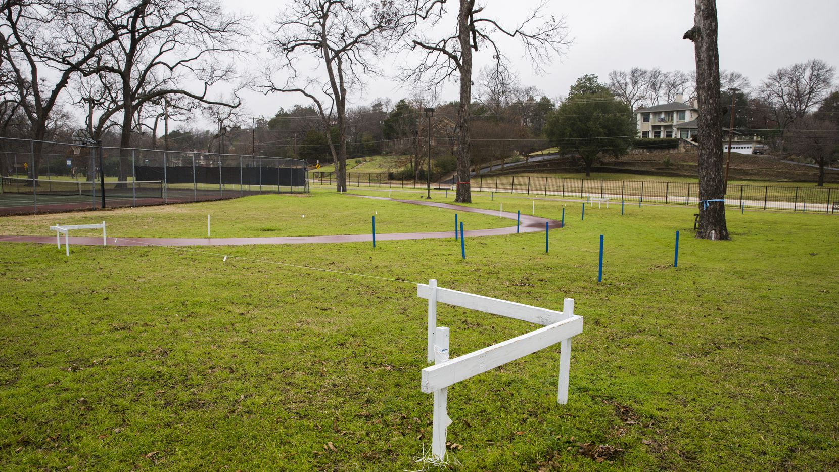 A lawsuit was filed Monday on behalf of East Kessler Park resident Katherine Homan that seeks to invalidate a Feb. 13 City Council vote that cleared the way to build a new Folsom Fitness Center in the pecan grove on Methodist Dallas Medical Center's campus.