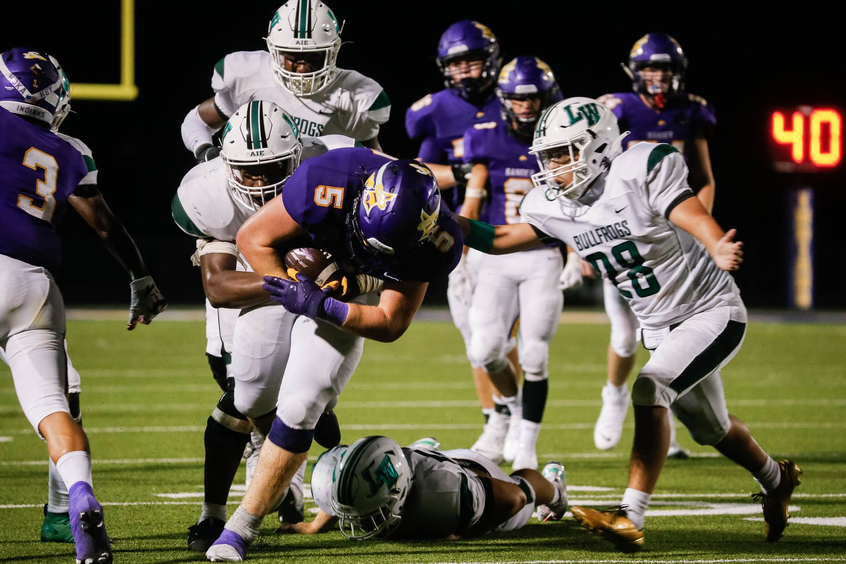 Sanger High School player Tallyn Welborn (5) is taken down by the Lake Worth High School's defense during the second half of a game on Sept. 4, 2020 in Sanger. Sanger won 49-35. (Juan Figueroa/ The Dallas Morning News)