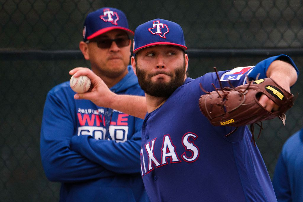 Texas Rangers pitcher Lance Lynn throws a bullpen session as pitching coach Julio Rangel looks on during a spring training workout at the team's training facility on Thursday, Feb. 14, 2019, in Surprise, Ariz.. (Smiley N. Pool/The Dallas Morning News)