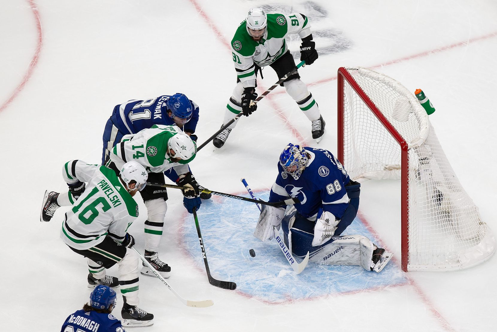 Jamie Benn (14) of the Dallas Stars takes a shot against goaltender Andrei Vasilevskiy (88) of the Tampa Bay Lightning during Game Two of the Stanley Cup Final at Rogers Place in Edmonton, Alberta, Canada on Monday, September 21, 2020. (Codie McLachlan/Special Contributor)