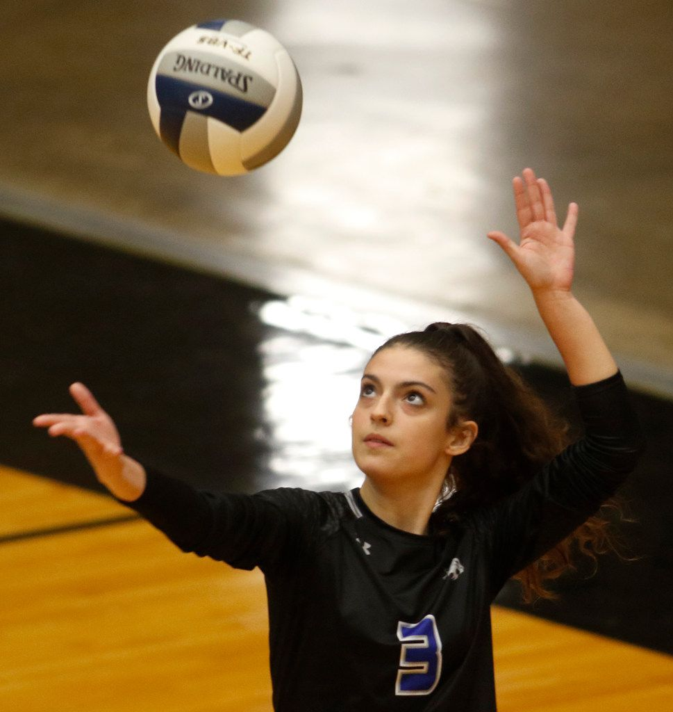 Trophy Club Byron Nelson's Gia Santini (3) focuses as she serves during the 2nd game of their match against Denton Guyer. Byron Nelson prevailed, 25-18, 25-17, 25-16 to advance to the state tournament. The two teams played their Class 6A Region l championship volleyball match at W.G. Thomas Coliseum in Haltom City on November 16, 2019. (Steve Hamm/ Special Contributor)