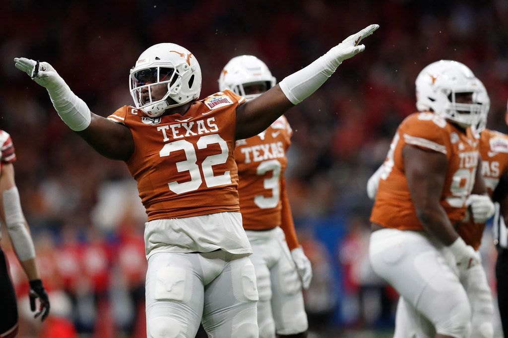 SAN ANTONIO, TX - DECEMBER 31:  Malcolm Roach #32 of the Texas Longhorns celebrates a tackle in the second quarter against the Utah Utes during the Valero Alamo Bowl at the Alamodome on December 31, 2019 in San Antonio, Texas.  (Photo by Tim Warner/Getty Images)