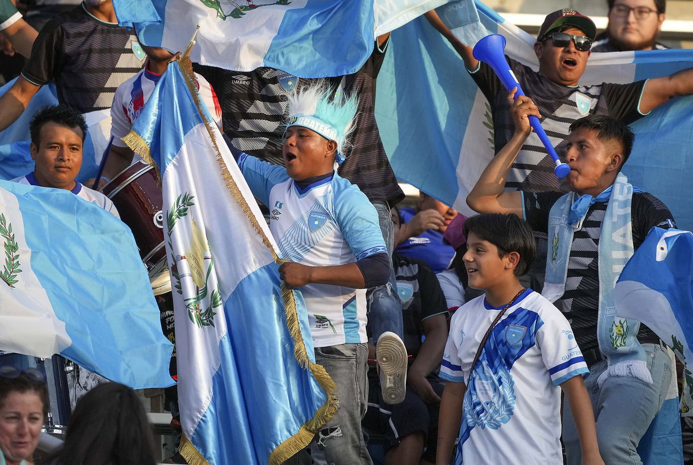 Guatemala supporters cheer as their team takes the field to warm up before a CONCACAF Gold Cup Group A soccer match against Mexico at the Cotton Bowl on Wednesday, July 14, 2021, in Dallas.