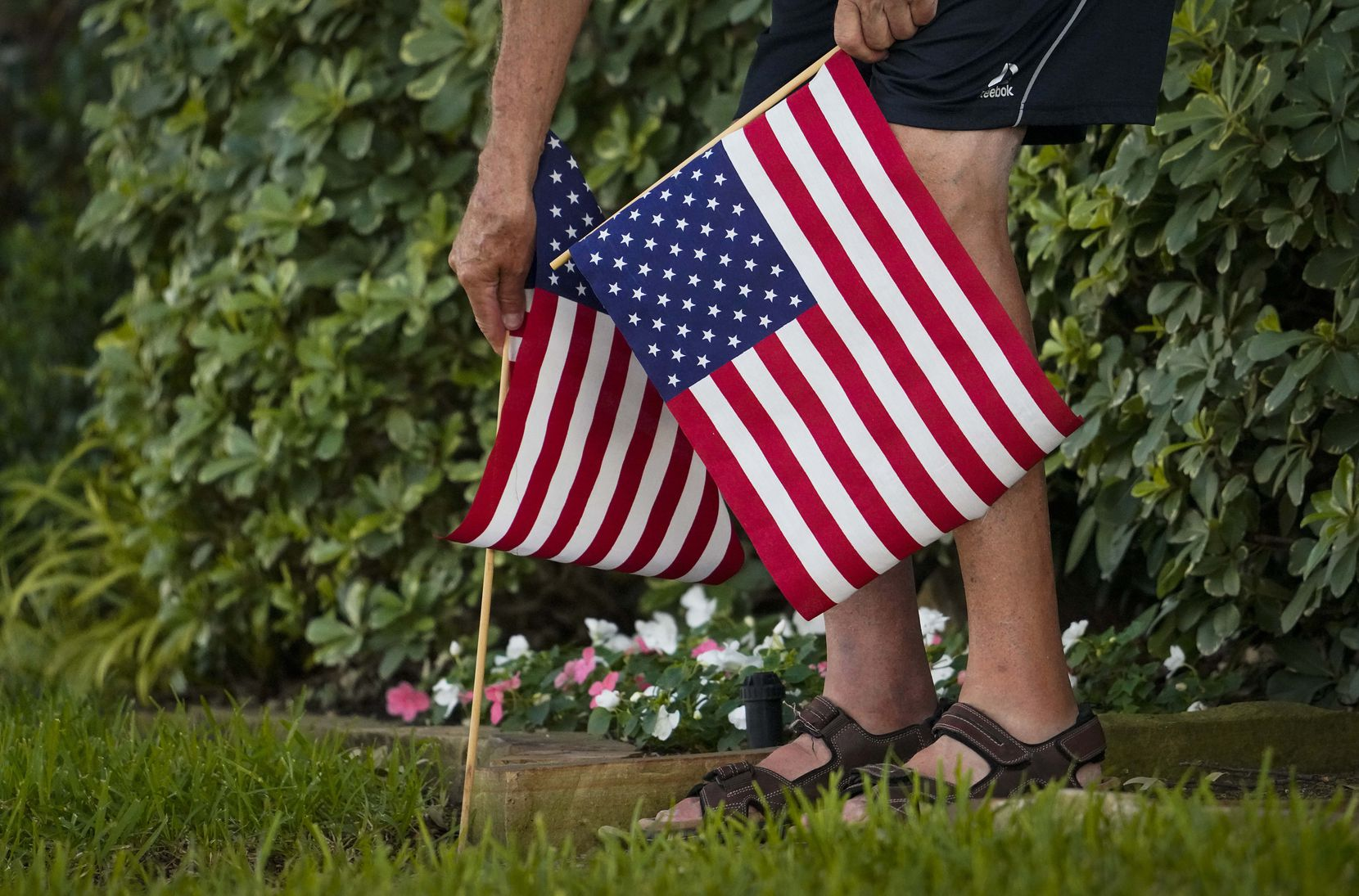 I resident places American flags in their yard in the Canyon Creek subdivision on Thursday, July 2, 2020, in Richardson.