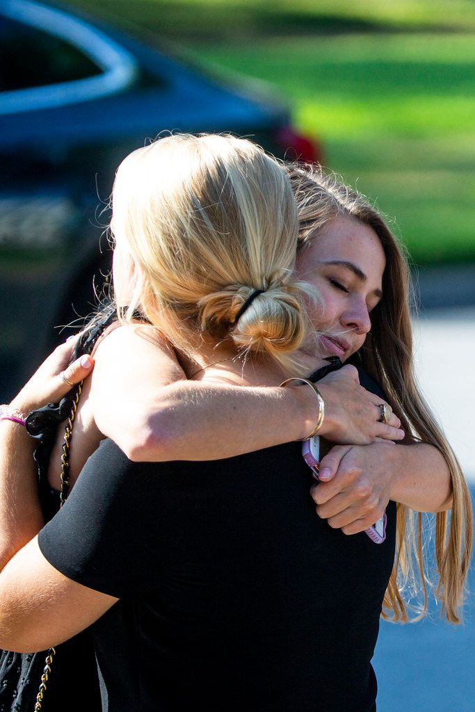 Mourners embrace following Sara Hudson's funeral at Saint Michael and All Angels Episcopal Church in Dallas on Monday, August 26, 2019. (Shaban Athuman/Staff Photographer)
