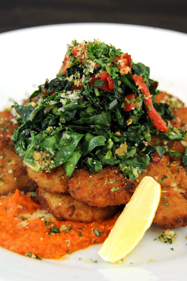 The cauliflower Milanese features romesco sauce, super greens, and golden raisin-mint gremolata at Patrizio in Uptown.