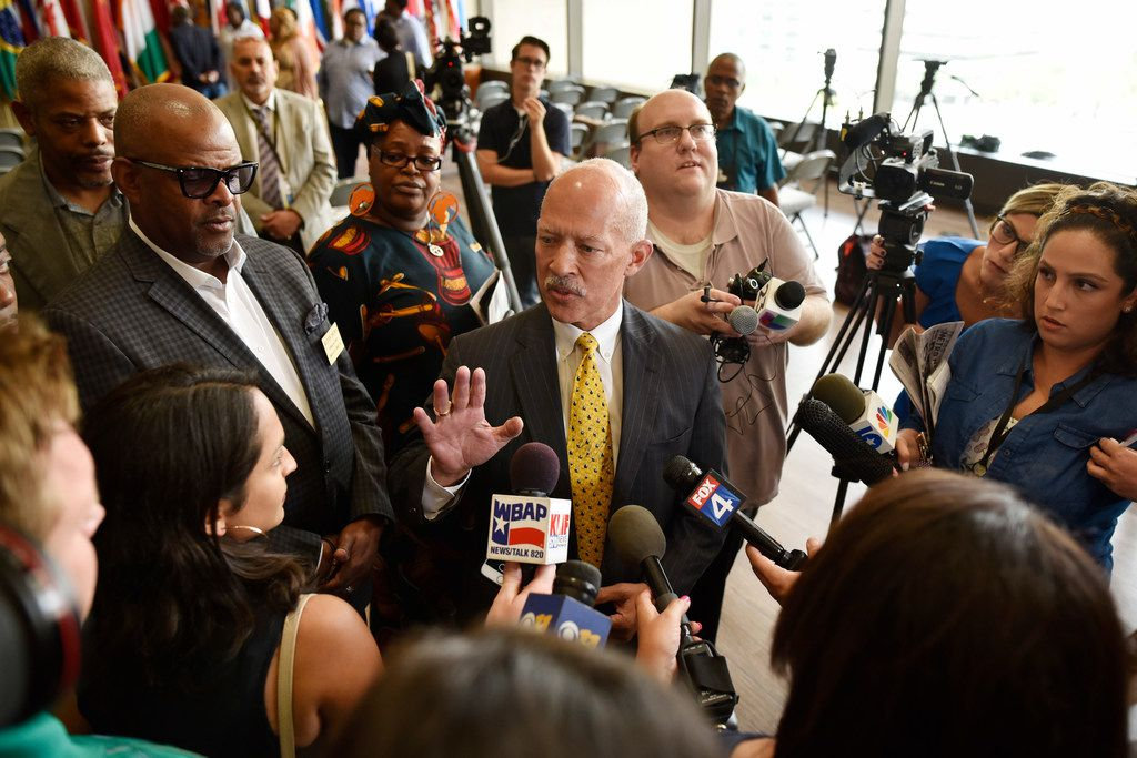 Dallas District Attorney John Creuzot is interviewed by reporters after a press conference with Dallas city councilmen speaking out about the heavy presence of troopers in South Dallas on Thursday Aug. 1, 2019, at Dallas City Hall.
