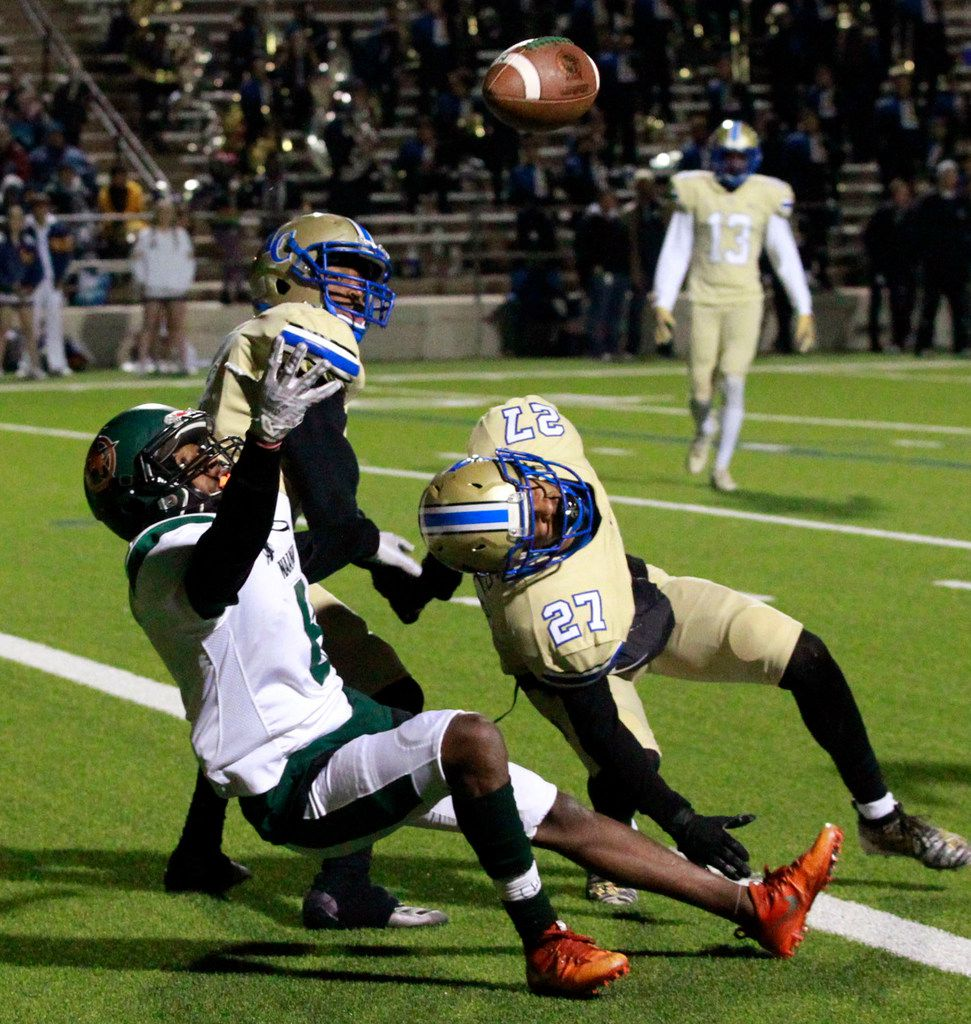 Maanam Forest Kieran Wright (8) can't make the catch, as he is double-teamed  by a pair of Naaman Forest defenders, including Michael Ayers (27) during the first half of their high school football game at Homer B. Johnson Stadium on Friday, November 8, 2019. (John F. Rhodes / Special Contributor)
