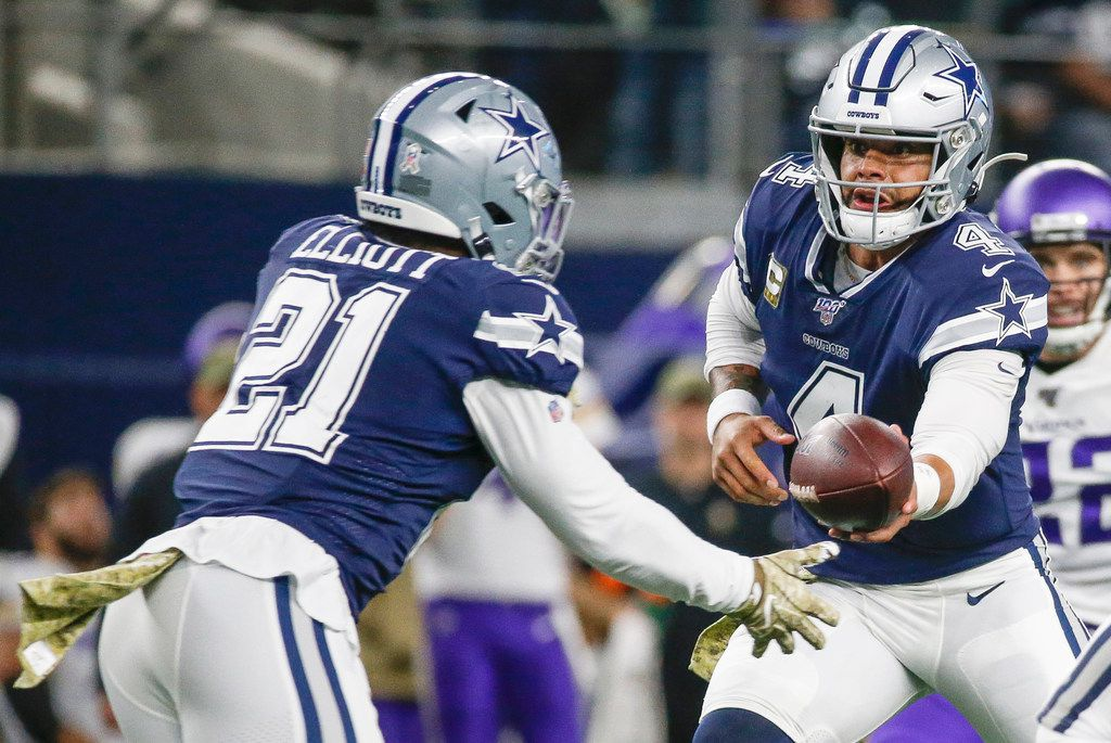 Dallas Cowboys quarterback Dak Prescott (4) hands off to running back Ezekiel Elliott (21) during the first quarter of an NFL football game between the Dallas Cowboys and the Minnesota Vikings at AT&T Stadium in Arlington, Texas, on Sunday, Nov. 10, 2019. (Ryan Michalesko/The Dallas Morning News)
