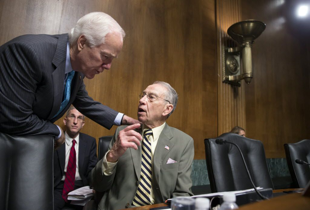 Sen. John Cornyn, R-Texas, the Senate majority whip, left, confers with Senate Judiciary Committee Chairman Chuck Grassley, R-Iowa, whose panel is responsible for vetting judicial appointments, at a hearing shortly after President Barack Obama announced Judge Merrick Garland as his nominee to replace the late Justice Antonin Scalia on the Supreme Court, on Capitol Hill in Washington, Wednesday, March 16, 2016.