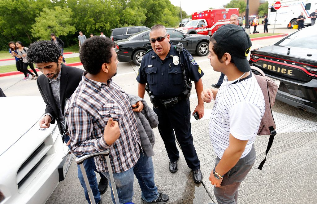 A DART police officer talks with students.