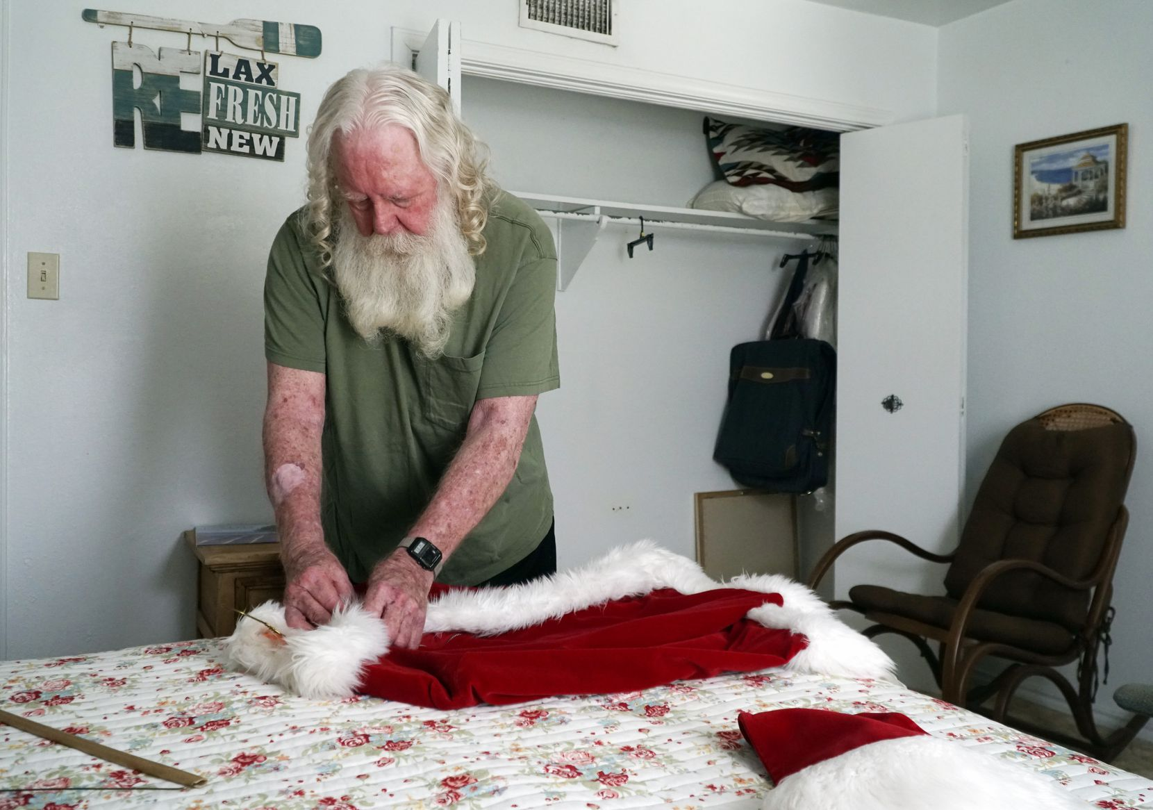 Allen Cole takes out his Santa Claus suit. He says his white beard is real and has been since the '70s.