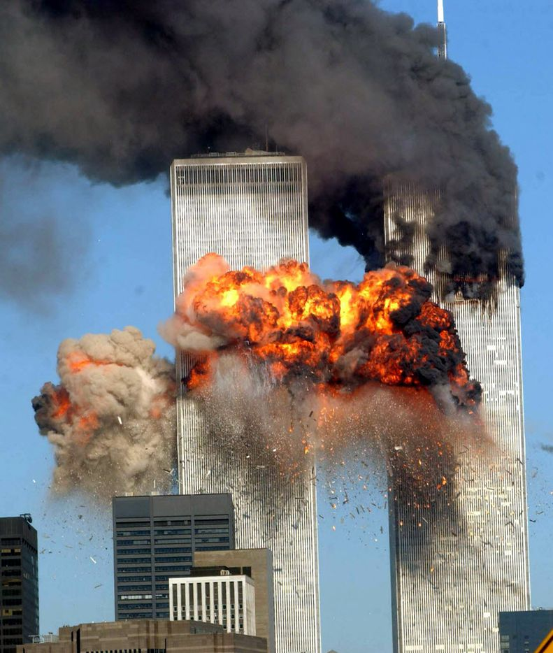 NEW YORK - SEPTEMBER 11, 2001: A fiery blasts rocks the south tower of the World Trade Center as the hijacked United Airlines Flight 175 from Boston crashes into the building September 11, 2001 in New York City.