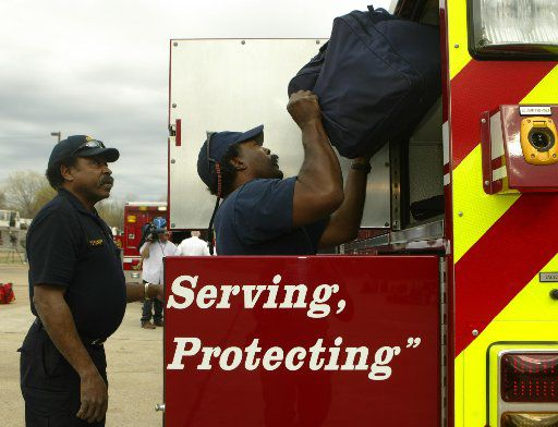 J.V. Smith (left) and Marcus Evans prepared to head to help fight grass fires in Childress on  March 15, 2006.