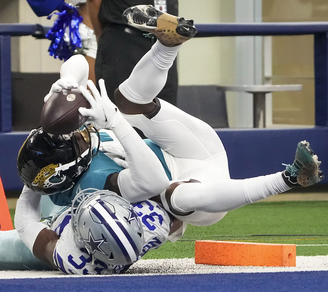 Jacksonville Jaguars wide receiver Laqoun Treadwell (18) goes in to the end zone for a touchdown past Dallas Cowboys defensive back Deante Burton (33) during the second half of a preseason NFL football game at AT&T Stadium on Sunday, Aug. 29, 2021, in Arlington. (Smiley N. Pool/The Dallas Morning News)