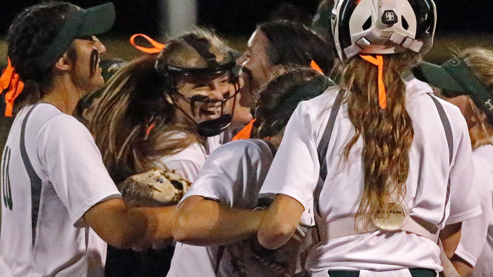 Prosper pitcher Elissa Griffin (16) is mobbed by team mates after winning their series as Prosper High School hosted Ft. Worth Boswell High School in game two of a best of three series 6A Region I semifinal softball game in Prosper on Thursday night, May 20, 2021.