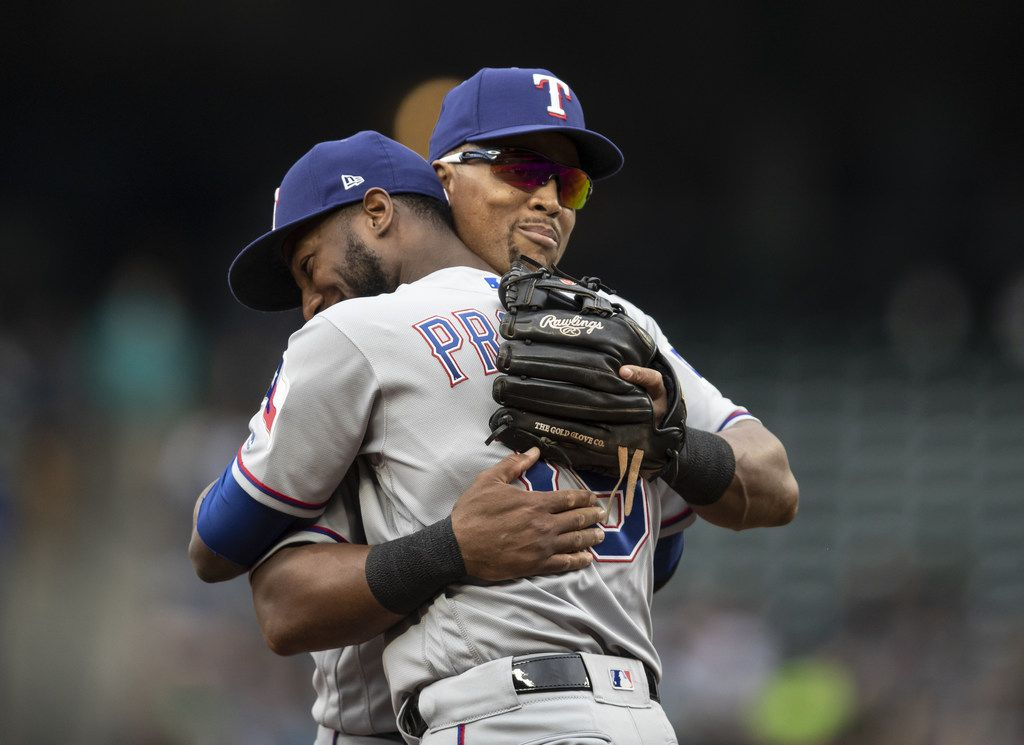 SEATTLE, WA - SEPTEMBER 30: Third baseman Adrian Beltre #29 of the Texas Rangers get a hug from Jurickson Profar #19 of the Texas Rangers as he is replaced during the fifth inning of a game against the Seattle Mariners at Safeco Field on September 30, 2018 in Seattle, Washington. The Mariners won the game 3-1. (Photo by Stephen Brashear/Getty Images)