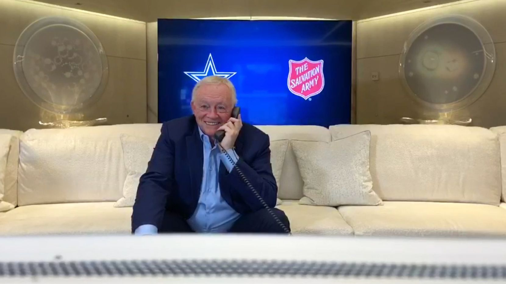 Screen capture of Dallas Cowboys owner and general manager Jerry Jones as he talks on the phone as the Cowboys make CeeDee Lamb of Oklahoma the 17th pick in the first round of the NFL Draft on Thursday, April 23, 2020. Due to the coronavirus pandemic the NFL Draft was held virtually. (Dallas Cowboys)