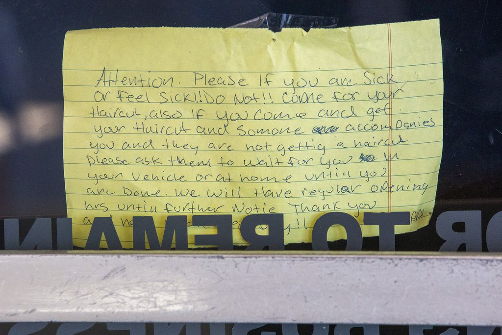 A sign informs customers about call-in measures at Chene's Salon in Pleasant Grove, in southeast Dallas.