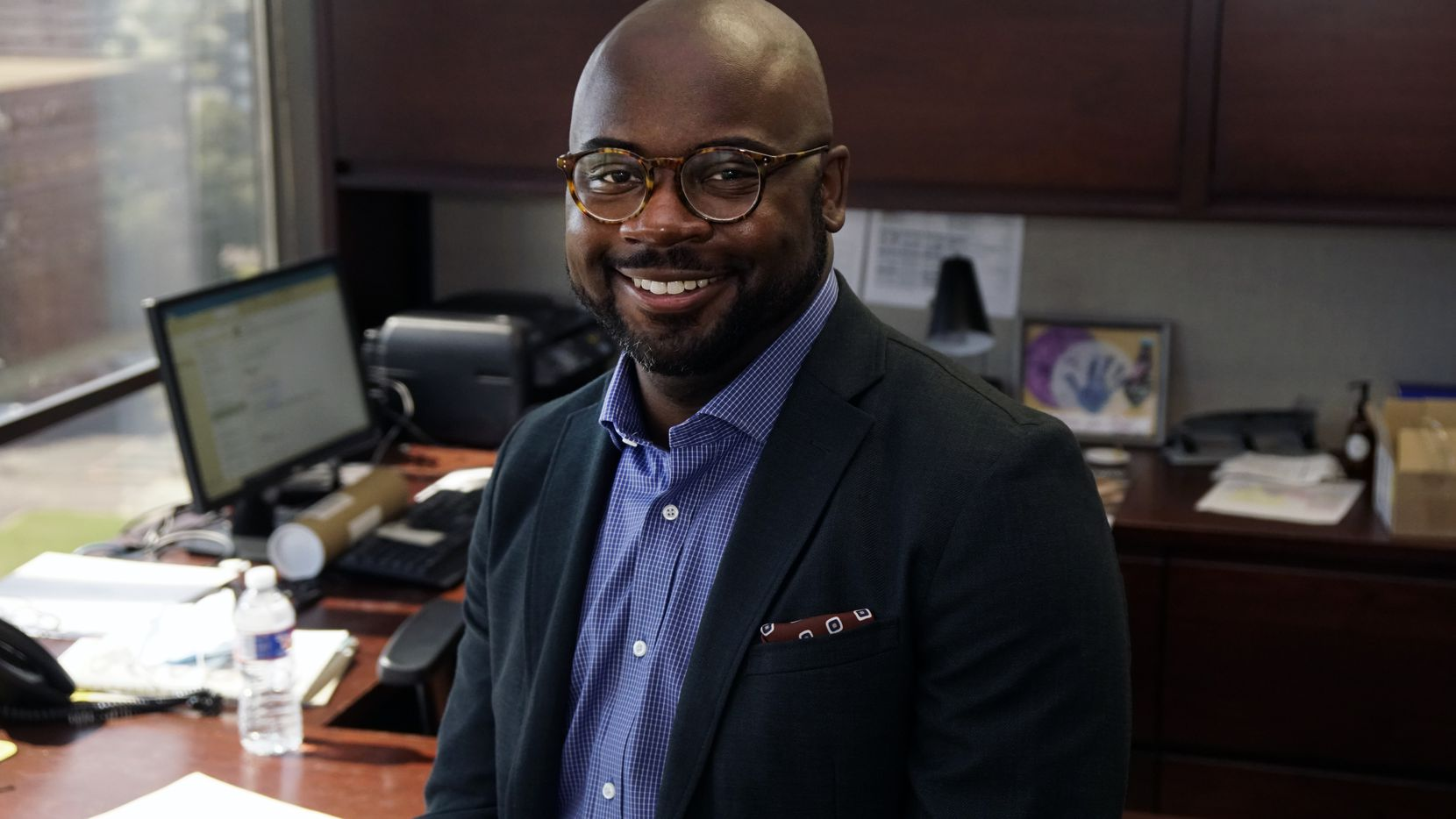"""Adam Powell, president and CEO of Communities in Schools Dallas Region, at his Love Field-area office Thursday. He says that when he met with CIS' board of directors about the job last year:  """"As soon as I heard the words mental health, I knew I would take it if it was offered."""""""