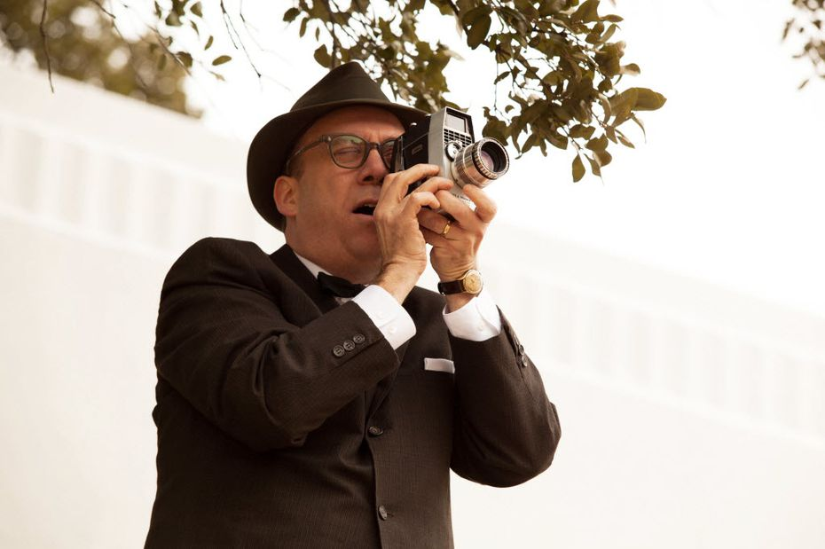 Actor Paul Giamatti plays Abraham Zapruder in a scene from the movie Parkland.
