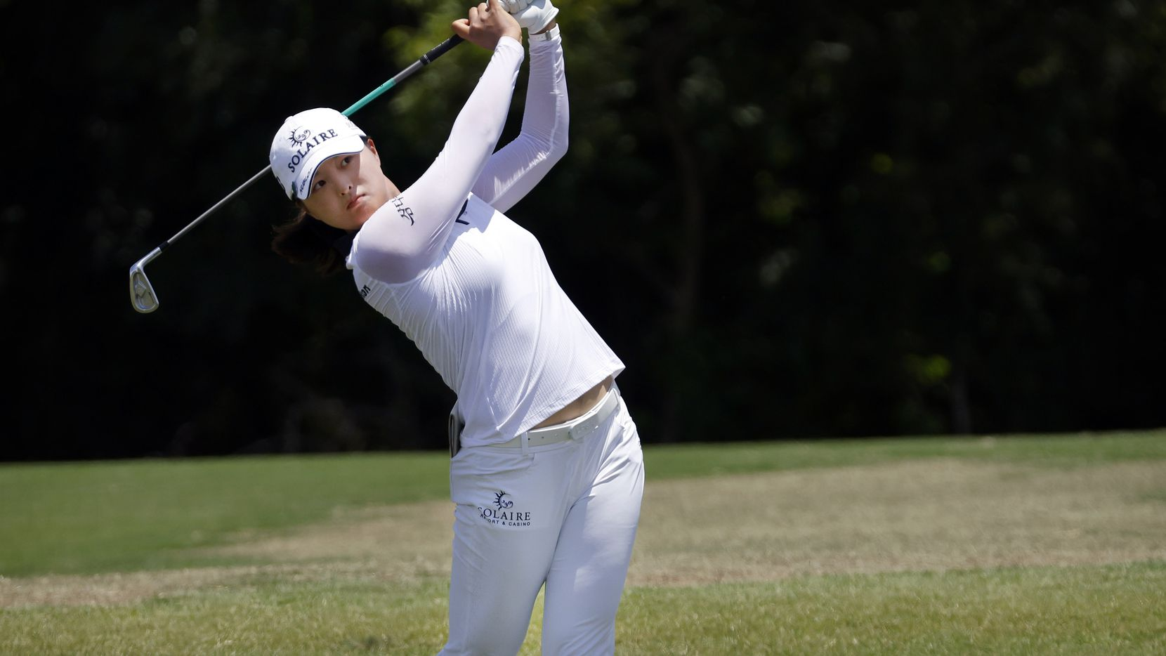 Professional golfer Jin Young Ko hits her approach shot on No. 9 during the opening round of the LPGA VOA Classic at the Old American Golf Club in The Colony, Texas, Thursday, July 1, 2021. She finished parred the hole and finished  8-under on the day. (Tom Fox/The Dallas Morning News)