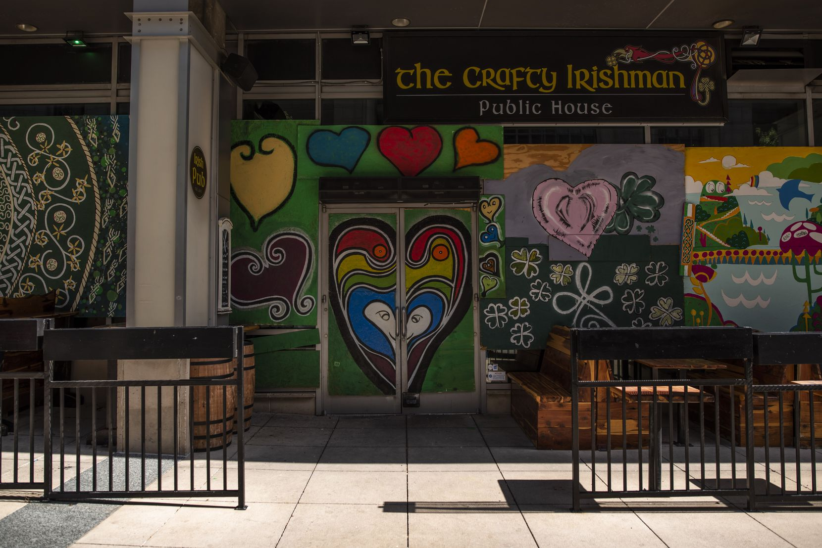 The Crafty Irishman restaurant on Main Street in downtown Dallas is boarded up and temporarily closed.