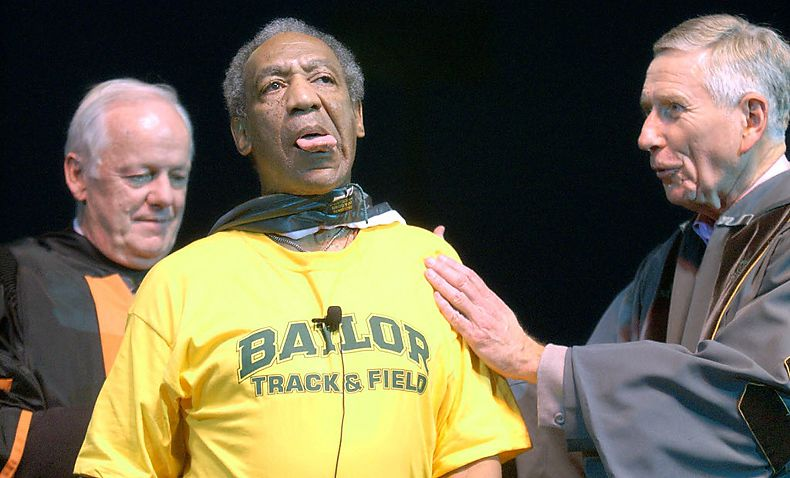 Comedian Bill Cosby clowns around while receiving a cloak and honorary Doctorate of Humane Letters from Baylor University Provost David Jeffrey (back) and Regent Drayton McLane Jr. in September 2003. Baylor's board of regents voted Thursday to rescind the honorary doctorate.