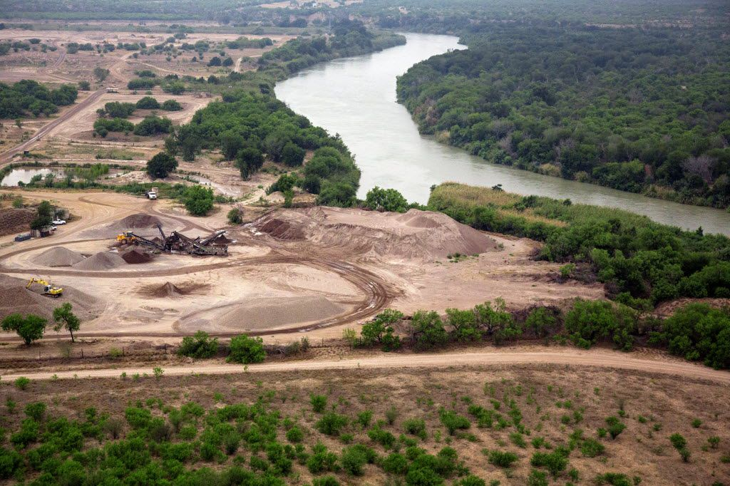 Development at the southern edge of the Eagle Ford Shale can be seen at left, with the Rio Grande River separating the United States from Mexico (right) in this aerial image from  2014.