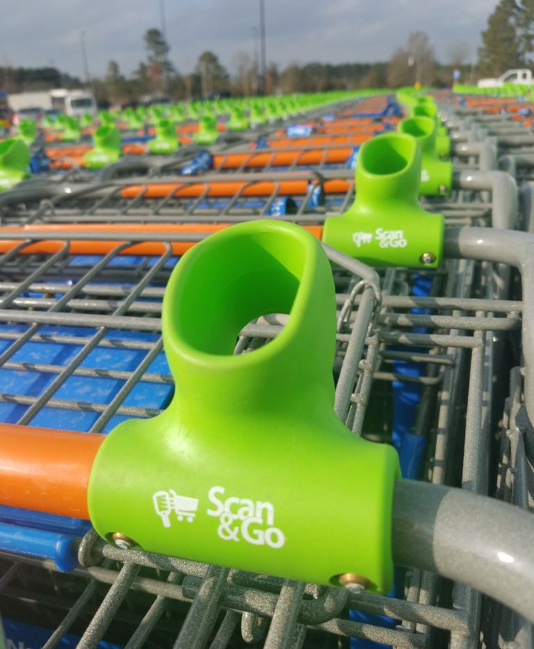 Wal-Mart s Scan & Go system of handheld scanners was added to 10 Wal-Mart stores in North Texas on Aug. 12, 2017. Dallas-Fort Worth area Sam s Clubs have had the scan-as-you-shop system since October.  The system also works from a Scan & Go app customers can download to iPhone and Android smartphones.