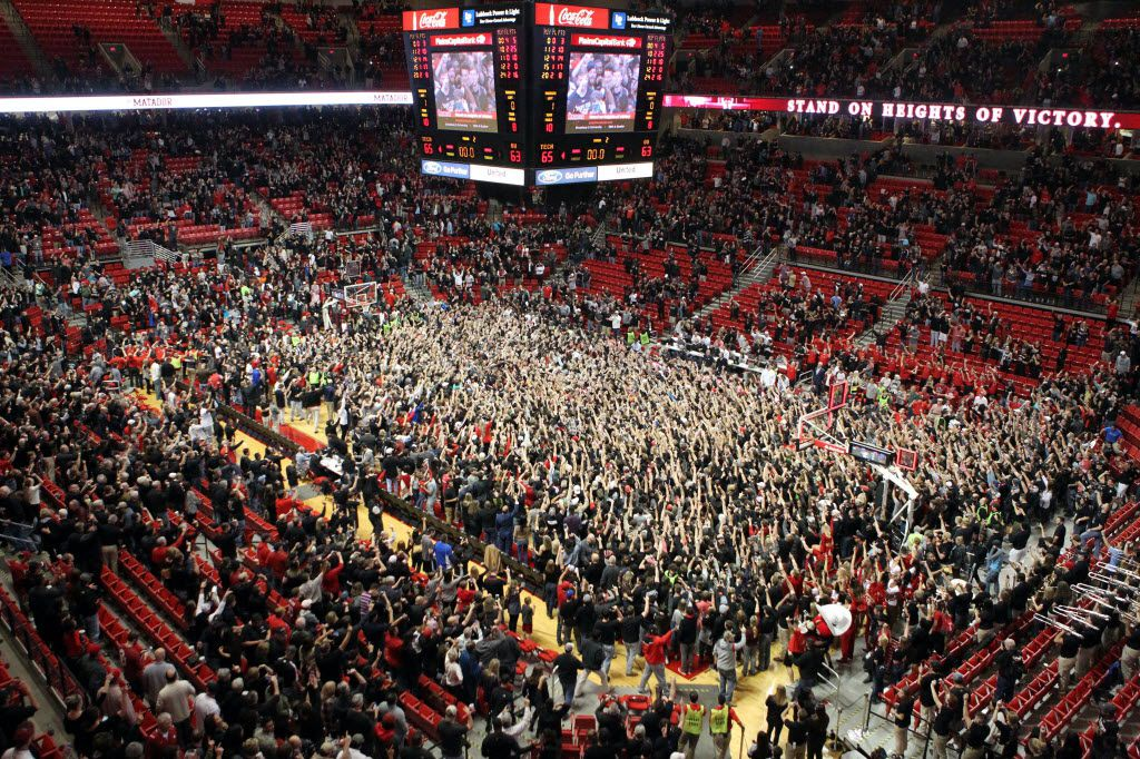 Feb 17, 2016; Lubbock, TX, USA; The Texas Tech Red Raiders student body storms the court after the Red Raiders defeated the Oklahoma Sooners at United Supermarkets Arena. Texas Tech defeated Oklahoma 65-63.  Mandatory Credit: Michael C. Johnson-USA TODAY Sports