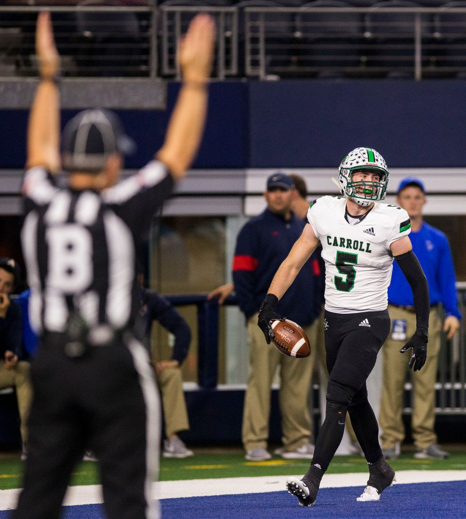 Southlake Carroll wide receiver Owen Allen (4) celebrates a touchdown during the first quarter of a Class 6A Division I area-round high school football playoff game between Southlake Carroll and DeSoto on Friday, November 22, 2019 at AT&T Stadium in Arlington. (Ashley Landis/The Dallas Morning News)