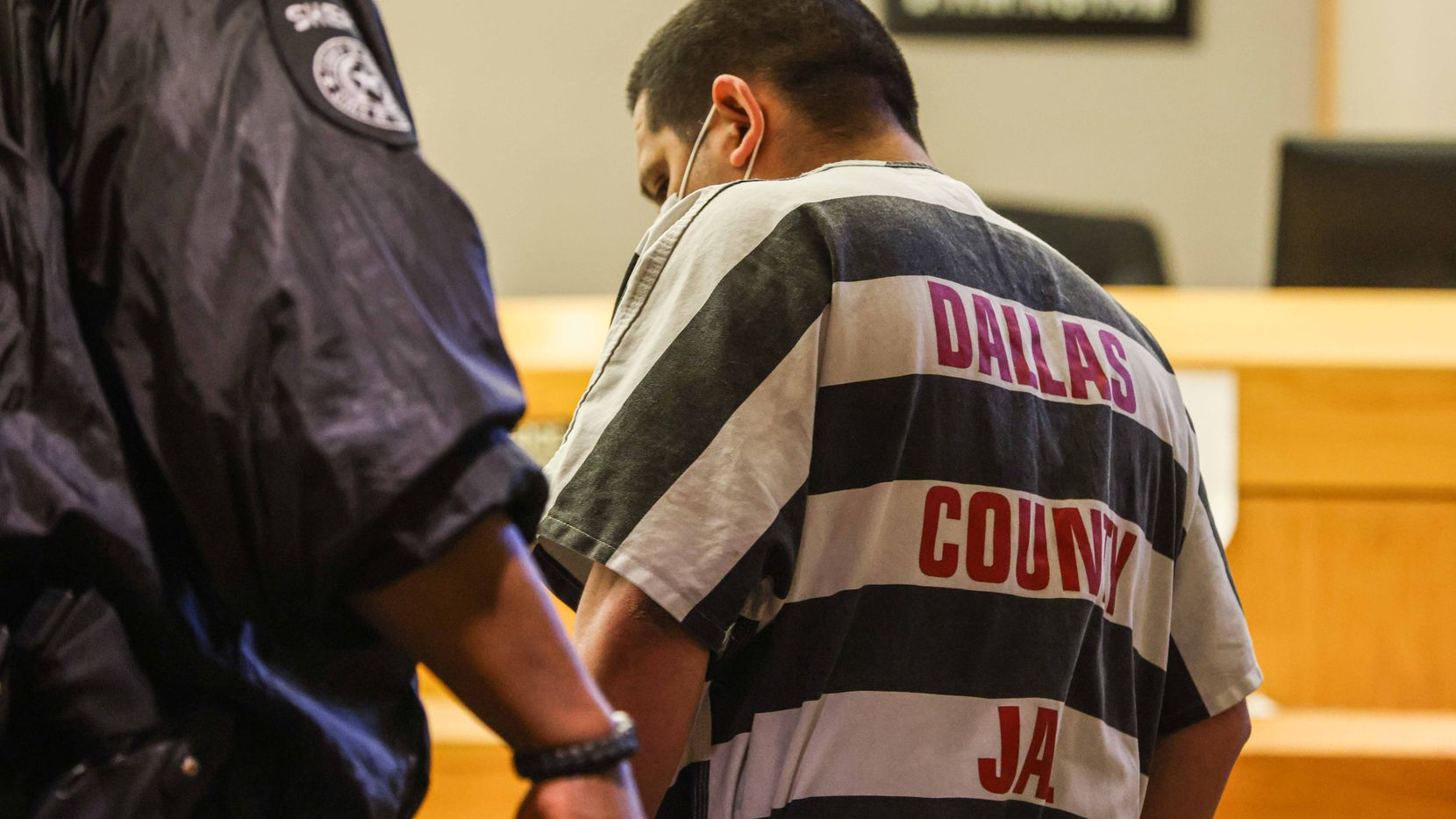 Armando Juarez enters the court Friday, Jan. 15, 2021, to plead guilty in the slaying of Dallas police Officer Rogelio Santander.