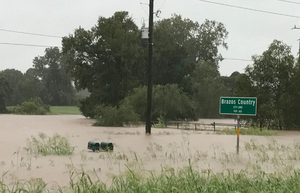 Floodwater from the Brazos River nearly reaches a pair of mailboxes in Brazos Country, Texas, south of Interstate 10 and west of Houston, as rain from Tropical Storm Harvey continues to inundate the area. (Charles Scudder/Staff)