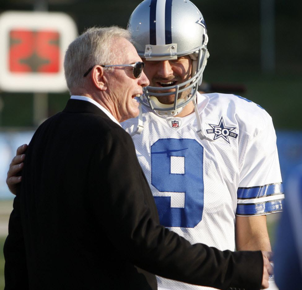Dallas Cowboys Tony Romo talks with owner Jerry Jones before the start of a game against the Cincinnati Bengals at Fawcett Stadium in Canton, Ohio, on August 8, 2010. (Vernon Bryant/The Dallas Morning News)