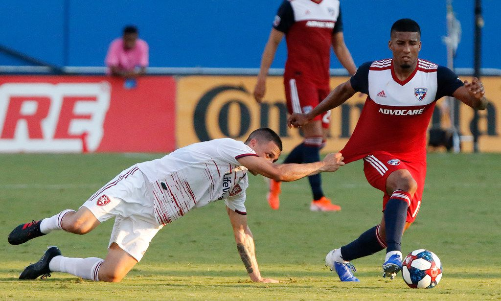 Real Salt Lake defender Donny Toia (4) wasn't called for holding the jersey of FC Dallas midfielder Santiago Mosquera (11) during the first half as FC Dallas hosted Real Salt Lake at Toyota Stadium in Frisco on Saturday, July 27, 2019.  (Stewart F. House/Special Contributor)