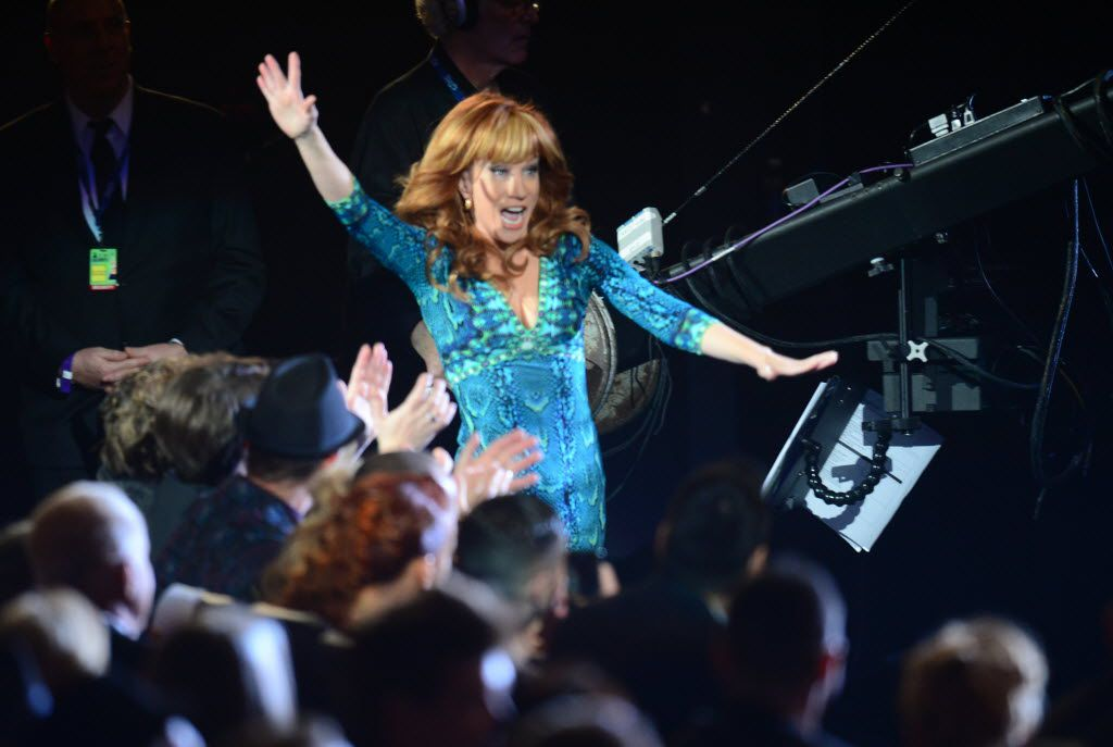 Winner For Best Comedy Album Kathy Griffin arrives to give her acceptance speech on stage at the pre-telecast show for the 56th Grammy Awards at the Nokia Theater in Los Angeles, California, January 26, 2014.